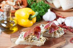 JAMON IBERICO ON TOAST. FOOD Royalty Free Stock Photo