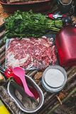 Jamon on handmade wooden table in forest.Selective focus Stock Images