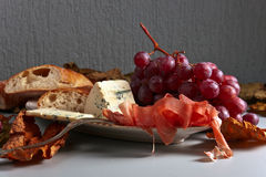 Jamon and red wine Stock Images