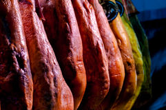 Jamon in row in La Boqueria market at Barcelona Royalty Free Stock Image
