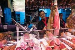 Jamon Seller in  La Boqueria Market in Barcelona, Spain Stock Images
