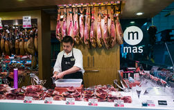Jamon Seller in  La Boqueria Market in Barcelona, Spain Royalty Free Stock Photo