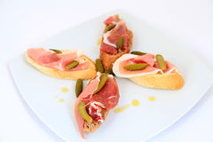 Jamon. Serrano ham, prosciutto served on bread. Tapas Royalty Free Stock Photography