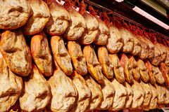 Jamon serrano ham from Spain whole in a row Stock Photos