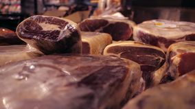 Jamon serrano. Traditional Spanish ham in the market close up. Gourmet Meat sell in retail store. Jamon serrano.Traditional Spanish ham in the market close up stock video footage