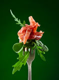 Jamon with spinach and arugula Stock Photo