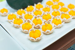 Jamongkut a traditional Thai dessert. Ja (chief) Mongkut (crown) is a kind of crown-like yellow pastry mainly made of yolk and sugar stock images