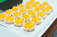 Jamongkut a traditional Thai dessert. Ja (chief) Mongkut (crown) is a kind of crown-like yellow pastry mainly made of yolk and sugar Royalty Free Stock Image