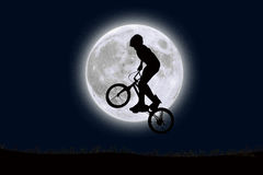 Jamping with a bike to the big moon in the sky Stock Image