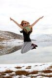 Jamping girl. Mountains lake lanscape Royalty Free Stock Photos