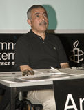 Jamshid Ahmadi speaking at Amnesty Conference Stock Photography