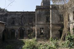 Jamunadighi, Burdwan, India - January 2018: Ruins of a Zamindar or landlords mansion in the village of rural bengal. It is in a quite dilapidated state stock photography