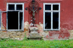 Jan Hojan. Czech Republic strange old home with an empty cross ramshackle in an abandoned house domov Royalty Free Stock Photo