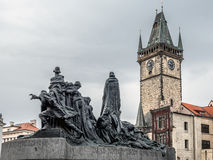 Jan Hus monument and Old Town City Hall Royalty Free Stock Image