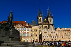 Jan Hus Monument. Tourists sitting in front of the Jan Hus Monument in the Old Square, Prague Stock Photos