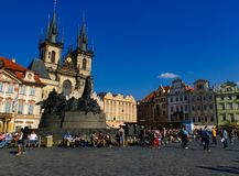 Jan Hus Monument. Tourists sitting in front of the Jan Hus Monument in the Old Square, Prague Stock Image