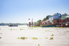 JAN 28 2014 - MY THO, VIETNAM - Houses by a river, on JAN  28, 2 Stock Photos