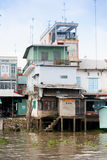 JAN 28 2014 - MY THO, VIETNAM - Houses by a river, on JAN  28, 2 Stock Image