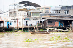 JAN 28 2014 - MY THO, VIETNAM - Houses by a river, on JAN  28, 2 Royalty Free Stock Images