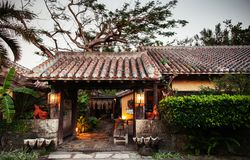 Japanese Okinawa style house with tiles roof in garden royalty free stock photo