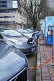 Jan 19, 2018 - Portland Or: Electric Vehicles Charging. Jan 19, 2018 - Portland Or: Electric vehicle charging at a public charging station in a city setting Stock Images