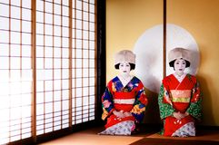 Japanese Maiko, Geisha in red and blue costume sit in Japanese r. JAN 23, 2014 : Sakata, Yamagata, Japan : Japanese Maiko, Geisha in red costume, traditional Stock Photography