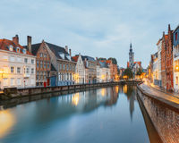 Jan van Eyck Square over the waters of Spiegelrei, Bruges Royalty Free Stock Photo