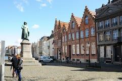 Jan van Eyck square. This is the Jan Van Eyck Place in Bruges, with the statue of Jan Van Eyck. Jan Van Eyck was a very good painter in the 15th century in the Stock Image