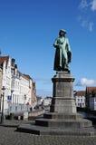 Jan van Eyck square. This is the Jan Van Eyck Place in Bruges, with the statue of Jan Van Eyck. Jan Van Eyck was a very good painter in the 15th century in the Stock Photos