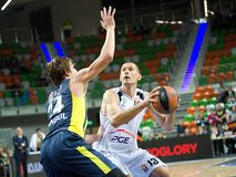 Jan Veselý and Filip Dylewicz. 2nd round Euroleague basketball match between the PGE Turow Zgorzelec and Fenerbahce Ülker Istanbul. Played in Lubin on stock photos