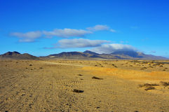 Jandia Natural Park in Fuerteventura, Canary Islands, Spain. Desert landscape in Jandia Natural Park in Fuerteventura, Canary Islands, Spain Stock Photo