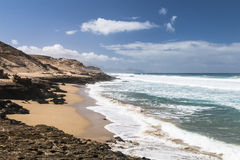 Jandia North Beach, Fuerteventura. View of a beach at the northern coast of Jandia with its rock formations in Fuerteventura, Spain Stock Image