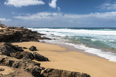 Jandia North Beach, Fuerteventura. View of a beach at the northern coast of Jandia with its rock formations in Fuerteventura, Spain Royalty Free Stock Photos
