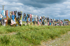 Jandle Fence. Jandle is what New Zealanders wear on their feet mostly in the hot summers. And when they are finish with them they hang them you on a fence Stock Image