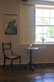 Jane Austen's Writing Table. This is English Writer Jane Austen's Writing Table featured in the Jane Austen House Museum in Chawton. On this small table she Royalty Free Stock Image