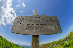 Jane Bald Sign. A fisheye lens captures the brilliant blue sky above the Jane Bald elevation marker stock photo