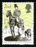 Jane Eyre UK Postage Stamp. GREAT BRITAIN - CIRCA 2005: A used postage stamp from the UK, depicting an illustration dedicated to the work of Charlotte Bronte Royalty Free Stock Image