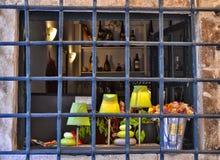 Janela barrada com várias decorações para dentro Imagens de Stock Royalty Free