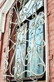 Janela com barras de ferro imagens de stock royalty free