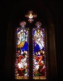 Janela de vitral de incandescência, cores vibrantes, iluminação temperamental Foto de Stock