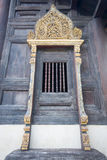 Janela de Wat Phan Ta, um templo budista Imagem de Stock