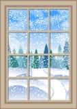 Janela do Natal do inverno com uma vista do cartão de Natal nevado da floresta Imagens de Stock Royalty Free