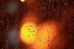 Janela molhada da textura abstrata com brilho Imagens de Stock