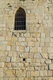 Janela na parede da torre velha Foto de Stock Royalty Free