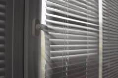 Janela plástica com cortinas foto de stock