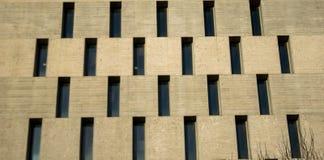 Janelas pequenas em uma construção Fotografia de Stock