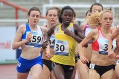 Janet Achola - 1500 metrar körning Arkivbilder