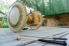 The janggu or janggo Traditional Korean drum with beating Sticks on the wooden table. The janggu or janggo or sometimes called seyogo means slim waist drum is royalty free stock photo