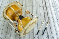 The janggu or janggo Traditional Korean drum with beating Sticks on the wooden table. The janggu or janggo or sometimes called seyogo means slim waist drum is royalty free stock image