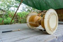 The janggu or janggo Traditional Korean drum with beating Sticks on the wooden table. The janggu or janggo or sometimes called seyogo means slim waist drum is stock images